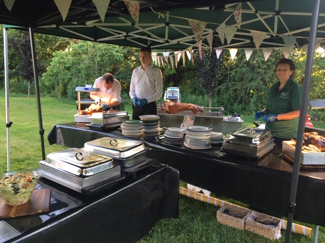 Meat being carved for guests at a party in Lechlade - catering by All Events Hog Roast