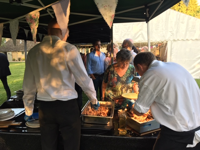 Lamb and turkey being served for guests at a party in Lechlade - catering by All Events Hog Roast
